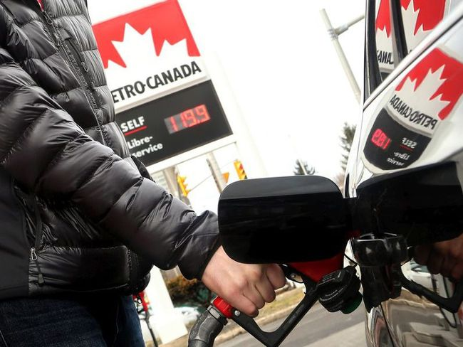 Ottawa resident David Allard watches the dollars rack up as he filled his tank at a Petro-Canada station on April 12, 2017. Julie Oliver / Postmedia Network