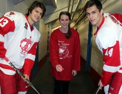 Sean Chase/Daily Observer Hosted by the Pembroke Business Improvement Area (PBIA), the third annual Downtown HockeySpree will be held in conjunction with the city's SnoSpree winter carnival on Saturday, Feb. 3. Here to promote the event is PBIA manager Heather Sutherland who is joined by Pembroke Lumber Kings winger Andre Simard (#14 right) and centreman Noah Maika (#13 left). The Kings will be officiating the games and meeting with fans.