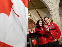 Tessa Virtue and Scott Moir will carry Canada's flag into the opening ceremony at next month's Winter Games in PyeongChang (Vincent Ethier/COC)