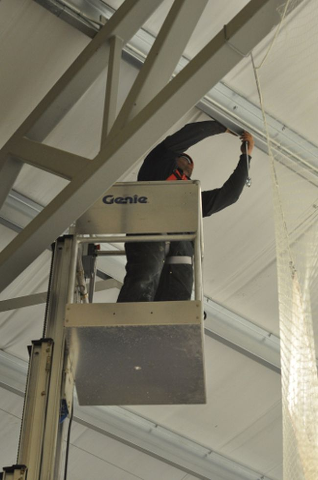Dave Nelson of GM Mechanical works on installing a heater Jan. 9 above the new wheelchair viewing area at the Tom Hornecker Recreation Centre. Stephen Tipper Nanton News