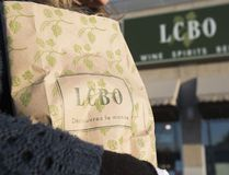 In this April 1, 2014 file photo, a woman carries an LCBO shopping bag filled with alcohol in Toronto, Ont. Ernest Doroszuk / Toronto Sun/Postmedia Network