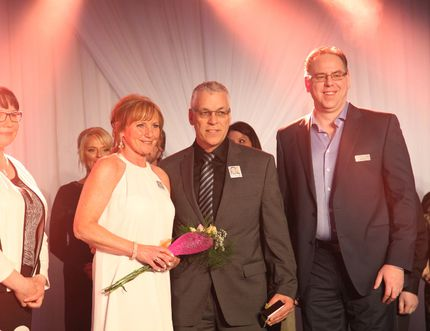 Gail and Brian Snook (center) accept flowers at the 27th annual Northern Light Health Foundation's Spring Fling gala on March 19, 2016, following an emotional tribute to their late son Jeremy who, at 19, lost his battle to brain cancer at the Northern Lights Regional Health Centre in March 2013. Olivia Condon/ Fort McMurray Today/ Postmedia Network