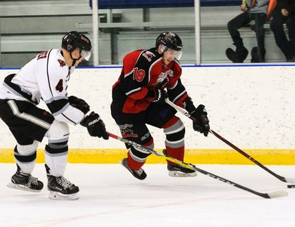 Tyler Bell of the Blackfalds Wranglers advances the puck into the offensive zone while guarded by Dalton Angeltvedt of the Red Deer Vipers during HJHL action at the Blackfalds Multi-plex Arena on Tuesday night. The Wranglers fell 6-5 in overtime to the Vipers, who currently are the league's top team. (Ashli Barrett/Lacombe Globe)
