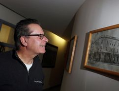 City of Selkirk mayor Larry Johannson looks at a photograph of the Merchant Hotel taken in 1913, which is hanging at the Selkirk Civic Centre. (Brook Jones/Selkirk Journal/Postmedia Network)