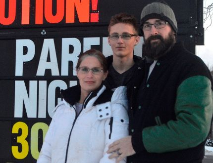 From left, Natasha Wright, Josh Schaafsma, and Ron Wright stand in front of one of their signs along Sunset Drive in St. Thomas, Ontario. A proposed bylaw in Central Elgin will require most portable signs along municipal roads be removed -- a decision that could ruin their five-year business. (Louis Pin/Times-Journal)
