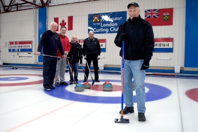 London Curling Club member Ken Walmsley also leads a committee responsible for organizing the club's annual fundraiser for prostate cancer research. Also pictured are fellow members Steve Bowden (left), Ron Reilh, John Brown, and Doug Petch. (CHRIS MONTANINI, Londoner)