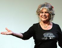 """In this Thursday Sept. 28, 2006 file picture, former French actress and sex-symbol Brigitte Bardot acknowledges applause prior to a press conference in Paris, France, as part of the 20th anniversary of her foundation for animal rights, the Brigitte Bardot Foundation. Bardot says most actresses are """"hypocritical"""" and """"ridiculous"""" in protesting sexual harassment because, she said, many of them """"tease"""" producers to land film parts. (AP Photo/Remy de la Mauviniere, File)"""