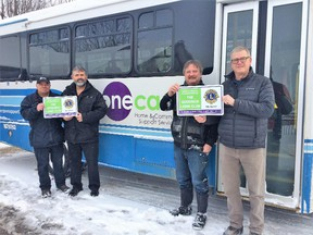 Goderich seniors are able to get groceries and take the worry out of winter driving with a free bus service on Tuesdays and Thursdays. This service is provided by the Goderich Lions Club and ONE CARE. Pictured here – ONE CARE driver Fred Nyland, Goderich Lions Club members, Dave McDonald, John Grace and Ron Kay. (Contributed photo)