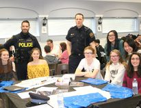 BRUCE BELL/THE INTELLIGENCER OPP Const. Pat Menard (left) and Prince Edward County firefighter Tim Kraemer are pictured with high school students from PECI, Quinte Secondary and Nicholson during the first C.H.A.T. conference at the Prince Edward Community Centre in Picton on Thursday.