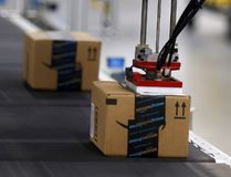 Product is automatically labelled along the conveyor inside the Amazon Fulfillment Centre in Brampton on Friday July 21, 2017. Dave Abel/Toronto Sun/Postmedia Network