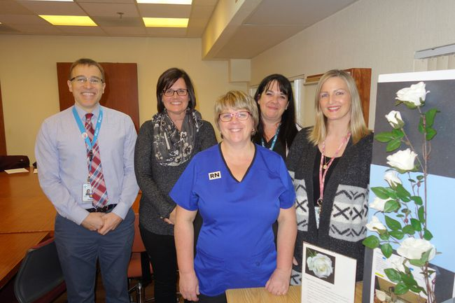 PHOTO SUPPLIED Hisham Karami, left, Teri Donald, Cindy O'Flaherty, Sandra Beida and Amanda Dreisbach are members of the QEII Regional Hospital team who pulled together to put the White Rose program in place.