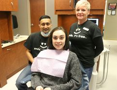 BRUCE BELL/THE INTELLIGENCER Kelsey Ubdegrove of Picton is pictured with Dr. Kuldeep Sandhu and hygenist Krista Lambert of Picton Dental Centre at the 6th Annual Dentistry From the Heart event on Friday.