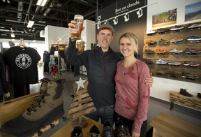 Aaron and Emily Hendrikx combine running and hiking shoe sales with craft beer at BackRoads Shoes and Brews. (MIKE HENSEN, Postmedia Network)