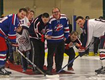 Members of the Austims Aspergers Friendship Society of Calgary were the special guests for a ceremonial puck drop at the Stony Plain Flyers and Spruce Grove Regals game on Jan. 12. The society attended the game and visited with players afterwards to thank the teams for donating jerseys to their newly formed ball hockey league.(Keenan Sorokan/Stony Plain Reporter)