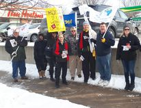 Union members joined together for an information picket at Kincardine's downtown Tim Hortons location as part of a National Day of Action against precarious work and low wages, which negatively impact those who rely on them for a living. Pictured: Grey Bruce Labour Council members huddled together for a photo in front of Kincardine's Tim Hortons to show support for workers across Ontario who live off low wages and a precarious work environment. (Troy Patterson/Kincardine News and Lucknow Sentinel)