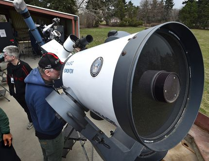 Astronomer Bruce McCurdy peers through a 16 inch mirror telescope that has an approximate focal length of 4000mm gazing at Venus's crescent phase at Telus World of Science Astronomy Days in Edmonton, Alta. on April 29, 2017. Ed Kaiser/Postmedia