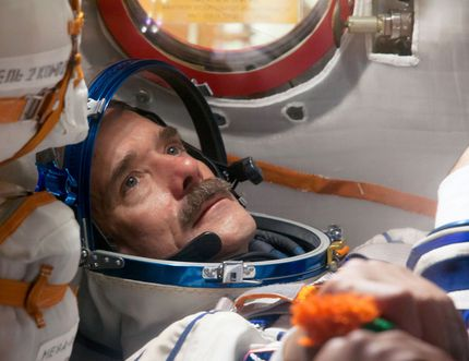 """NASA/Victor Zelentsov Flight Engineer Chris Hadfield of the Canadian Space Agency conducts a """"fit check"""" dress rehearsal inside the Soyuz TMA-07M spacecraft in 2012. Along with Soyuz Commander Roman Romanenko and Flight Engineer Tom Marshburn of NASA, who are not pictured, Hadfield was preparing for launch for a five-month mission on the International Space Station."""