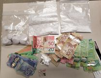 Norfolk OPP issued this photo of narcotics and cash seized Thursday during a major drug bust on Head Street North in Simcoe. The investigation yielded the largest amount of deadly fentanyl seized to date in the county. (Norfolk OPP)