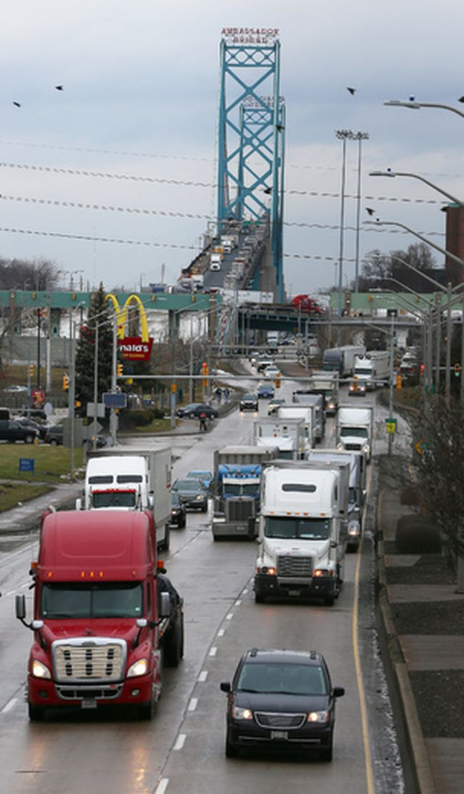 Thousands of trucks travel south on Windsor's Huron Church Road after exiting the international border crossing at the Ambassador Bridge.