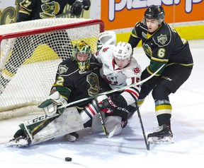 Knights defenceman Riley Coome forces Niagara Ice Dogs forward Oliver Castleman into London goalie Joseph Raaymakers during the first period of their OHL game at Budweiser Gardens on Friday night. (DEREK RUTTAN, The London Free Press)
