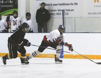 The Vulcan midgets Hawks played a home game against the Kainai Chiefs Friday but lost 4-1. In this photo: Jaxson Deitz manages to keep the puck away from the opposing team.