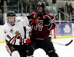 Chatham Maroons' Grant Spence (51) battles Sarnia Legionnaires' Zach Vanderwal (9) in front of the Legionnaires' net in the third period at Chatham Memorial Arena in Chatham, Ont., on Sunday, Jan. 21, 2018. (MARK MALONE/Chatham Daily News/Postmedia Network)