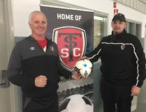 Head coach Phil Trueman, left, and president Rob Cameron of the St. Thomas Soccer Club announce a partnership with London TFC Academy. The partnership will allow athletes from St. Thomas to move forward with their soccer careers to a level not currently achievable in the city. (Laura Broadley/Times-Journal)