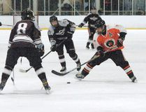 A North Park Collegiate player takes a shot on goal earlier this season against Pauline Johnson Collegiate during Brant County high school boys hockey action. (Expositor Photo)