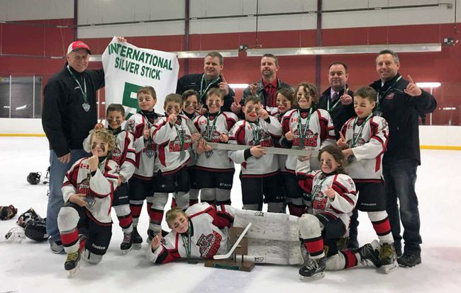 The Novice Rep. Sabres claimed International Silver Stick gold on the weekend of Jan. 14 in Pelham, Ont. Above the team celebrates. Back row from (l-r) are: assistant coach Derek McLaughlin, trainer Marty Debruyn,head coach Derrick Leenders, assistant coach Jeff Kerslake and assistant coach Paul Grant. Third row from (l-r) are: Cullen Kerslake and Ryan Obre. Second row from (l-r) are:  Kallen Grant, Cole Smale, Myles Phillips, Kane Barch, Drew Kramer, Hudson Leenders and Basil McLaughlin. Front row from (l-r) are Jesse Debruyn, Logan Morley and Jack Taylor. (Handout/Exeter Lakeshore Times-Advance)