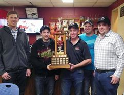 From left to right, Kyle Atkins from BrokerLink presents the BrokerLink Trophy to Casey Harvie, third, Craig Reid, lead, Shawn Smailes, second, and skip Brett McAllister. Smailes rink won the BrokerLink Major Curling League's championship by winning Sunday's final against Don Bartley's rink from Tara. Photo submitted.