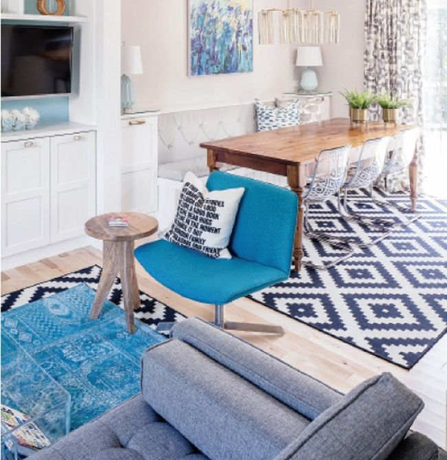 Emma Doucet used the same rug in the living room and dining room of a recent project. (JVL photo)