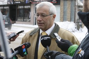 Nipissing MPP Vic Fedeli speaks to reporters Thursday in North Bay.