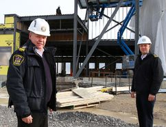 Tim Miller/The Intelligencer Quinte West fire chief John Whelan (left) and deputy fire chief Dan Smith stand in front of the ongoing construction of a new fire hall on Thursday in Trenton.
