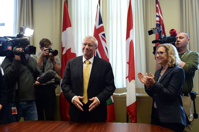 Ontario PC party interim leader Vic Fedeli is congratulated after a caucus meeting at Queen's Park in Toronto on Friday, January 26, 2018. Fedeli has been named interim leader of Ontario's Progressive Conservatives after Patrick Brown's resignation in the face of sexual misconduct allegations. THE CANADIAN PRESS/Nathan Denette