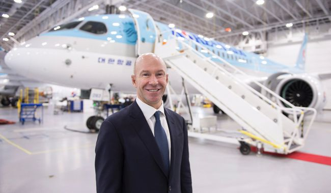 Bombardier president and CEO Alain Bellemare is seen next to a CSeries CS300 ready for delivery to Korean Air Thursday, December 21, 2017 in Mirabel, Que. THE CANADIAN PRESS/Paul Chiasson