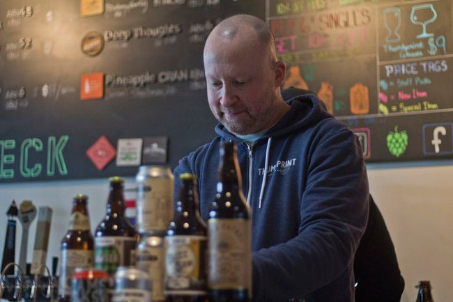 Thumbprint Craft Beer Market's Dave Fulton works away on Saturday, Jan. 20, 2018 during the market's one-year anniversary weekend.