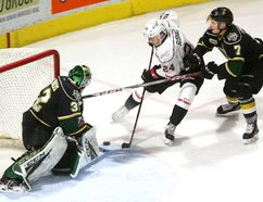 Knights goaltender Joseph Raaymakers uses his big goalie stick to stop Owen Sound's Maksim Sushko from moving to his forehand at the side of the Knight as Shane Collins of the Knights comes in to help in their Friday night game in Budweiser Gardens on Friday January 26, 2018. Mike Hensen/The London Free Press/Postmedia Network