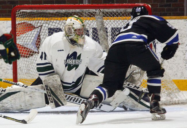 Nipissing Lakers goalie Brent Moran makes a left-pad save on UOIT Ridgebacks centre Ben Blasko (90) during OUA action at Memorial Gardens, Friday. Moran, a former North Bay Battalion goalie, made 35 saves to beat the Ridgebacks 3-2 and win a goalie battle against Brendan O'Neill (also a former Battalion), who stopped 26 of 29 in defeat. The Lakers next host the RMC Paladins for their 9th annual Military Appreciation Night tonight at the Gardens. Puck drop is 7:30 p.m.. Dave Dale / The Nugget