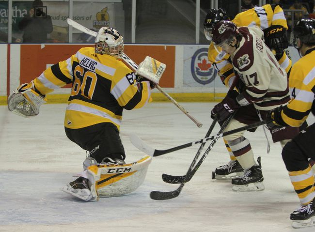 Kingston Frontenacs goaltender Jeremy Helvig gives out a rebound and the Peterborough Petes pounce during the first period of Ontario Hockey League action at the Rogers K-Rock Centre on Sunday. Helvig made 28 saves as the Fronts blanked Peterborough, 2-0. (Steph Crosier/The Whig-Standard/Postmedia Network)