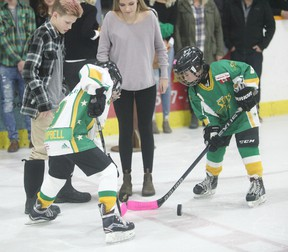 The community packed the Seaforth Arena Jan. 27 for the Seaforth Stars Dedication Night, an event honouring Tanner Steffler and Rebecca Kipfer-Pryce with a special three-on-three game between all ages. The two died last year, they were former hockey players of the Stars, and so a special unveiling of their jerseys was the main attraction. Here is the puck drop before the game. (Shaun Gregory/Huron Expositor)
