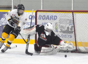Connor MacLean (12) of the Mitchell Bantams sniffs around the Listowel net and goalie Myles Novotony for a rebound during action from Game 2 of their OMHA 'B' playoff series last Wednesday, Jan. 24. The locals won 4-1. ANDY BADER/MITCHELL ADVOCATE