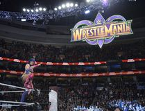 Asuka points to the WrestleMania 34 sign following her win in the inaugural women's Royal Rumble in Philadelphia on Sunday. (World Wrestling Entertainment)