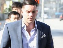 Mark Salling arrives for a court appearance at United States Courthouse - Central District of California on June 3, 2016 in Los Angeles, California. Salling is turning himself in to federal authorities and is scheduled to be arraigned on two charges of child pornography.Frederick M. Brown / Getty Images