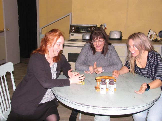 """Jack Evans/For The Intelligencer Seated around a table on the set of """"Marion Bridge"""" during a recent rehearsal are (from left to right) Kodie Trahan-Guay, Kayla Alexandropoulos and Kelsey Collins. The play opens Thursday at The Pinnacle Playhouse."""