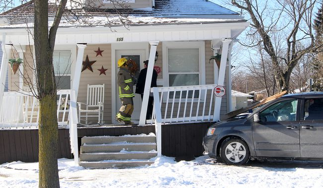 There were no injuries resulting from this minivan crashing into the porch of a Sandys Street home in Chatham, Ont. on Tuesday January 30, 2018. Damage to the porch is estimated at $2,000 and no charges are expected according to Chatham-Kent police. (Ellwood Shreve/Chatham Daily News/Postmedia Network)