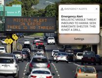 "In this Jan. 13, 2018, file photo provided by Civil Beat, cars drive past a highway sign that says ""MISSILE ALERT ERROR THERE IS NO THREAT"" on the H-1 Freeway in Honolulu. Cory Lum / Civil Beat via AP"