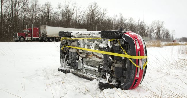 This van was involved in one of three crashes Tuesday within a few kilometres on Highway 402 just west of Centre Street, north of Strathroy. A heavy streamer made the road icy and decreased visibility. The van rolled over in the median, a semi ended upright in the ditch and a small SUV spun into the ditch. (MIKE HENSEN, The London Free Press)