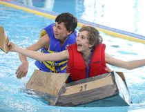 BRUCE BELL/THE INTELLIGENCER Grant Gailbraith (left) and Samuel Evans of Sacred Heart Catholic School in Batawa appear to be overjoyed their vessel floated during the Skills Ontario Cardboard Boat Races on Wednesday. More than 100 Grade 7 and 8 students from the Quinte and Kawartha regions gathered at the Quinte Sports and Wellness Centre for the one-day event.