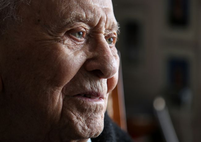 Tim Miller/The Intelligencer Dominic Angelo tells stories of more than a century of living in Trenton as he sits in his son's Belleville home Thursday. Angelo turns 105 today.