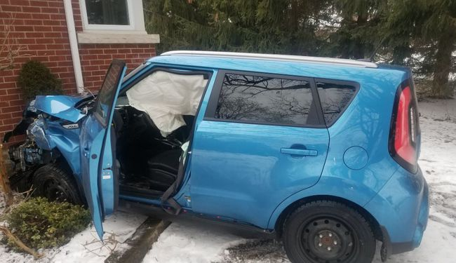 A driver suffered minor injuries when her vehicle struck a house near Simcoe on Thursday afternoon. Norfolk OPP photo